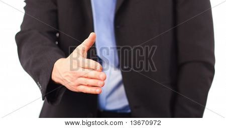 Businessman offering a handshake at camera