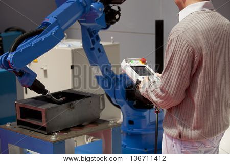 Industrial robot arm. Industrial welding robotic arm.