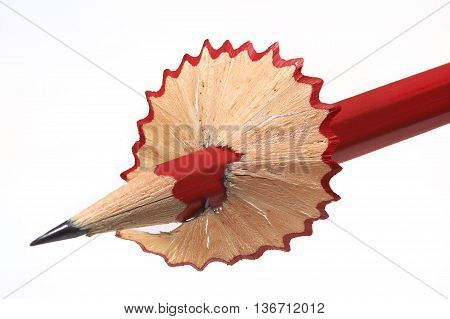 Red pencil with a petticoat from shavings