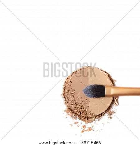 Broken bronze contour face powder with make up brush isolated on a white background forming a page border