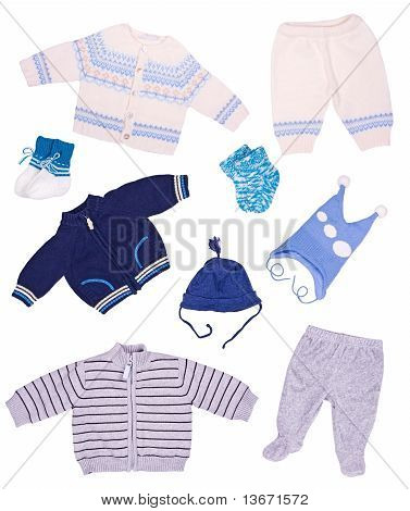 Clothes For The Newborn On A White Background
