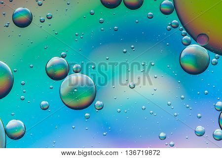 Psychedelic oil and water abstract background formed by oil droplets floating on water