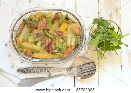 Casserole with potatoes chicken and green string bean, top view