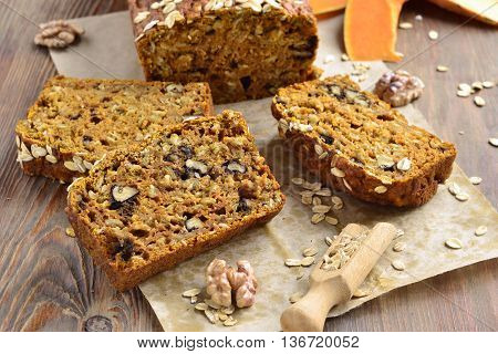 Pumpkin bread with oatmeal and walnuts, selective focus
