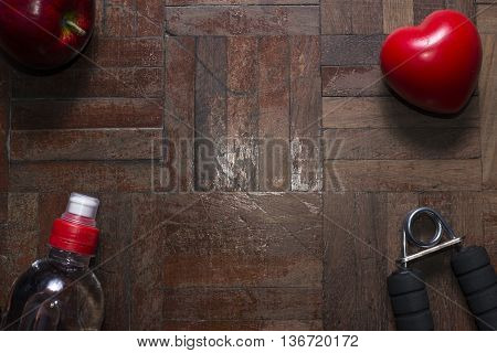 Fitness concept with bottle of dumbbell and hand grip