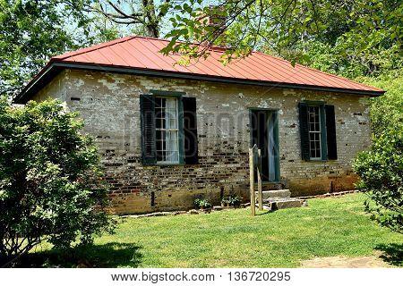 Hillsborough North Carolina - April 20 2016: Two room brick schoolhouse at the 1821 Burwell School for Women Historic Site