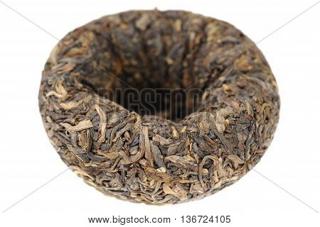 Raw green puerh tea bowl shape tuo cha closeup isolated