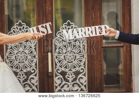 bride and groom with wooden word