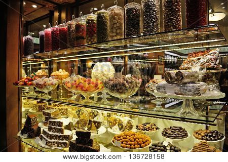the colorful showcase of an Italian patisserie