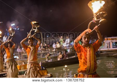 A Hindu Priest Performs The Ganga Aarti Ritual In Varanasi.
