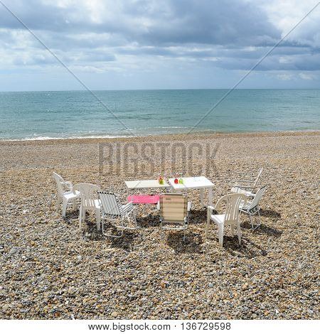 Empty table and chairs on Jurassic Coast in Seaton Devon