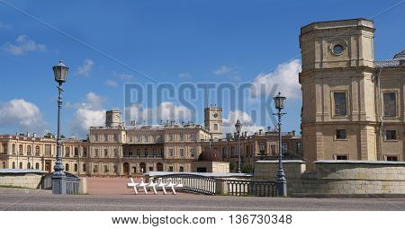 Gatchina Palace. Palace Square and the main entrance. Central building with balconies, lateral tower, lights and water moat.