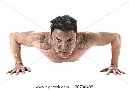 40 to 45 years old attractive fit man doing push up workout training hard fitness routine with strong and muscular body isolated on white background in health sport and bodybuilding concept