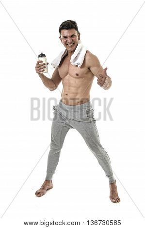 40s attractive hispanic sport man and bodybuilder posing corporate with naked torso showing fit and muscular body smiling happy with water bottle and towel in mature bodybuilding concept