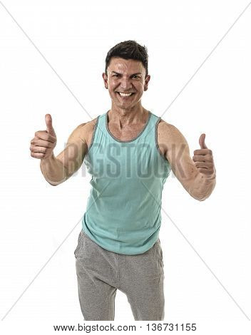 40s attractive hispanic sport man and bodybuilder smiling happy in corporate pose giving thumbs up wearing singlet having very fit and muscular body in mature bodybuilding and body care isolated