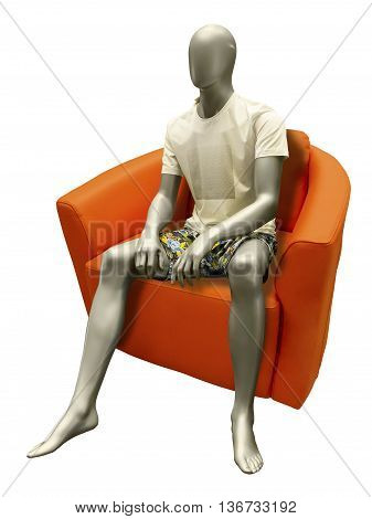Sitting male mannequin wearing summer dress. Isolated on white background. No brand names or copyright objects.