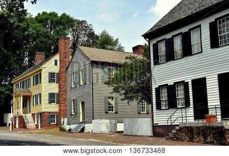 Old Salem North Carolina - April 21 2016: Three 18th century colonial wood frame houses all privately owned on the north end of Main Street