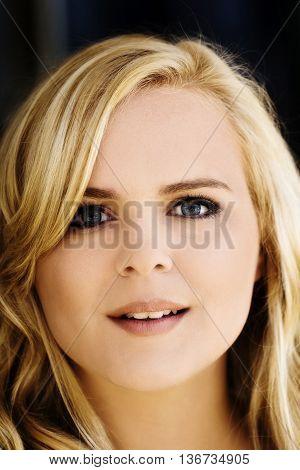 Portrait Of Attractive Caucasian Blond Woman Outdoors Plump