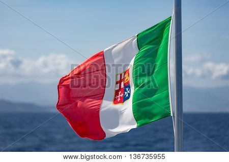 Waving Italian Flag at ferry between Sicily and Aeolian Islands