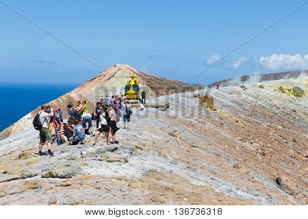 VULCANO ITALY - MAY 24: Rescue helicopter and people at top of volcano on May 24 2016 at Vulcano Island near Sicily Italy