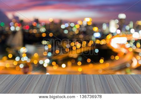 Opening wooden floor, Blurred bokeh city downtown lights night view