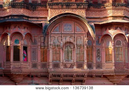 Woman At Window In Mehrangarh Fort In Jodhpur, Rajasthan,  India