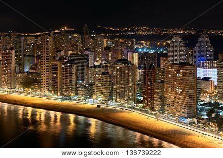 Illuminated skyscrapers of a Benidorm city at night. Costa Blanca Alicante province. Spain