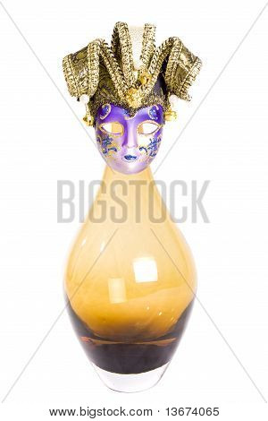 Glass vase with old-fashioned mask