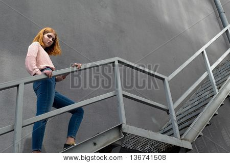 Red-haired Girl Down The Stairs