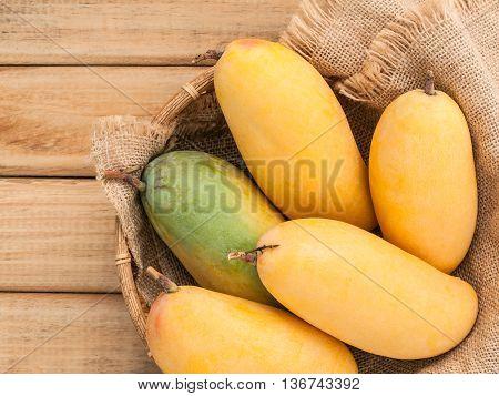 Fresh Organic Traditional Thai Mangoes High Vitamins And Minerals Set Up On Hemp Sack Background.