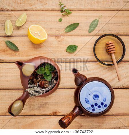 Herbal Tea Pot With Fresh Herbs Sage ,peppermint ,dried Chrysanthemum , Lime And Lemon Slice On Rust