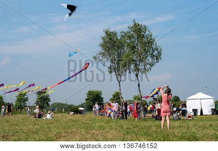 Saint-Petersburg Russia - June 26 2016: Kite Festival in the town of Pushkin. Girl starts a kite.