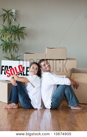 Young Couple relaxing after buying house