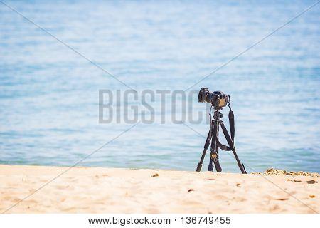 Camera on a tripod placed at sea.
