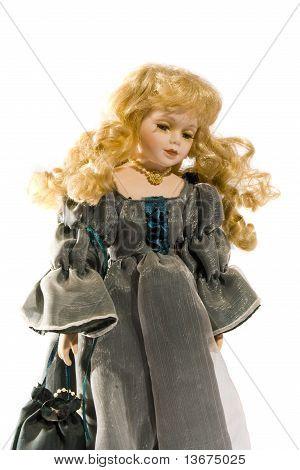 antique doll in silk dress