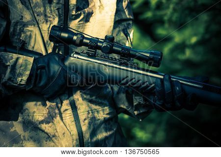 Hunter Rifle Closeup. Poacher Hunting Concept Photo.