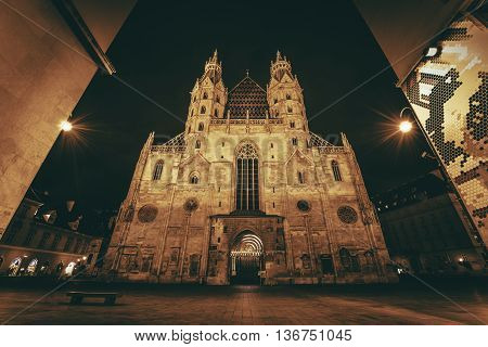 St. Stephen's Cathedral or Stephansdom Roman Catholic Archdiocese of Vienna Austria Europe. Cathedra at Night. Dark Sepia Color Grading.