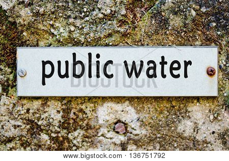 label for public water on old wall