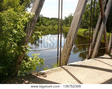 Crossing the historical truss bridge located outside a country village