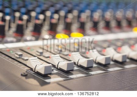 the controls of an Audio Mixing Console