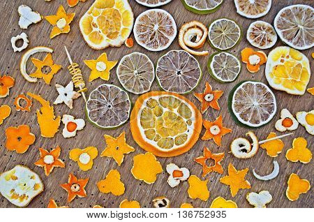 Dried Oranges, Tangerine, Lemon, Lime On Wooden Background.