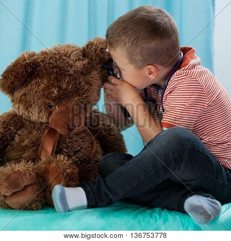 Boy Playing In Doctor