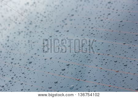 Rain drops on glass and dripping down