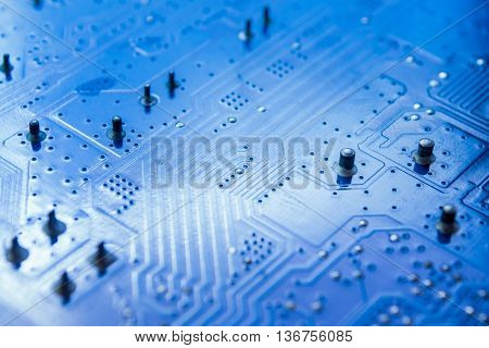selective focus of close up the computer electronic circuit board , blue color tone