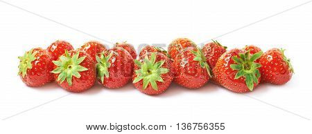 Line of ripe red strawberries isolated over the white background