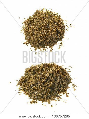 Pile of wet mate tea leaves isolated over the white background, set of two different foreshortenings