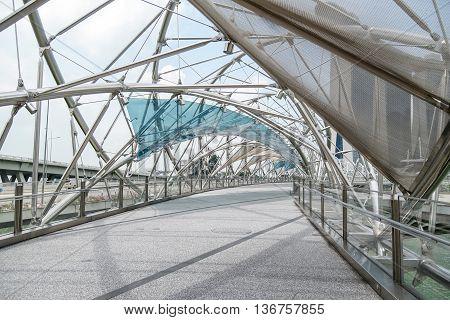 Helix bridge the pedestrian bridge of Marina Bay Sands Resort Hotel, one of landmarks in Singapore