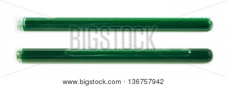 Glass test-tube filled with the green liquid, isolated over the white background, set of two different foreshortenings