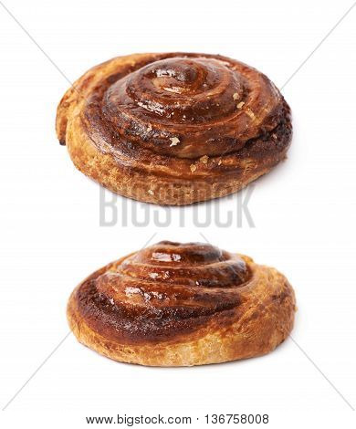 Cinnamon roll pastry bun isolated over the white background, set of two different foreshortenings