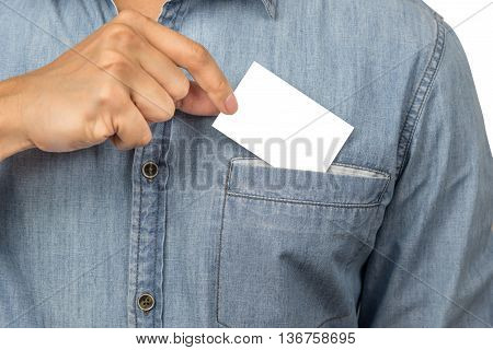 Man with jean shirt taking a blank business card with copyspace from his chest pocket isolated on white background with clipping path.
